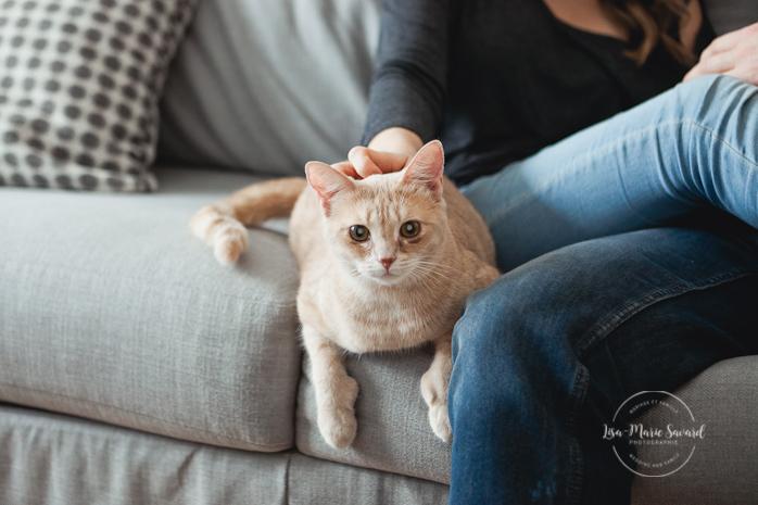 In-home lifestyle engagement session in the living room playing with cat. Séance de fiançailles couple romantique à la maison à Montréal |Lisa-Marie Savard Photographie |Montréal, Québec |www.lisamariesavard.com