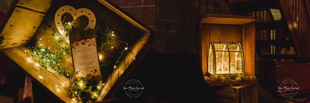 Rustic wedding reception decor geometric terrarium wild flowers fairy light string light wood menu wax seal flower arch. Julie et Denis mariage champêtre rustique à l'Abbaye d'Oka Montréal Laurentides |Lisa-Marie Savard Photographie |Montréal, Québec
