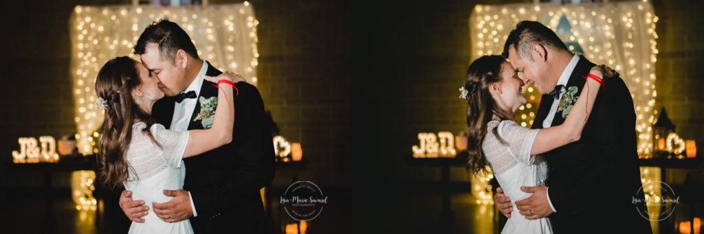 Rustic wedding reception rainy day bride and groom entrance first dance smiling kissing laughing. Julie et Denis mariage champêtre rustique à l'Abbaye d'Oka Montréal Laurentides |Lisa-Marie Savard Photographie |Montréal, Québec