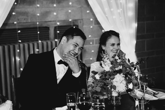Rustic wedding reception rainy day bride and groom honour table sitting speeches from groomsman and bridesmaids funny laughing smiling. Julie et Denis mariage champêtre rustique à l'Abbaye d'Oka Montréal Laurentides |Lisa-Marie Savard Photographie |Montréal, Québec