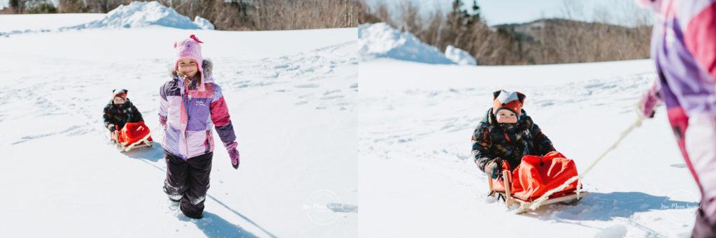 Winter outdoor family photos. Family photos snow. Parents and children sledding down the hill, playing in snow, snow fight, building snowmen snow sculptures. Family fun outside in the snow family playing together. Séance familiale extérieure en hiver à Montréal. Photos dans la neige à Montréal. Photographe lifestyle photos de famille à Montréal  Lisa-Marie Savard Photographie  Montréal, Québec   www.lisamariesavard.com