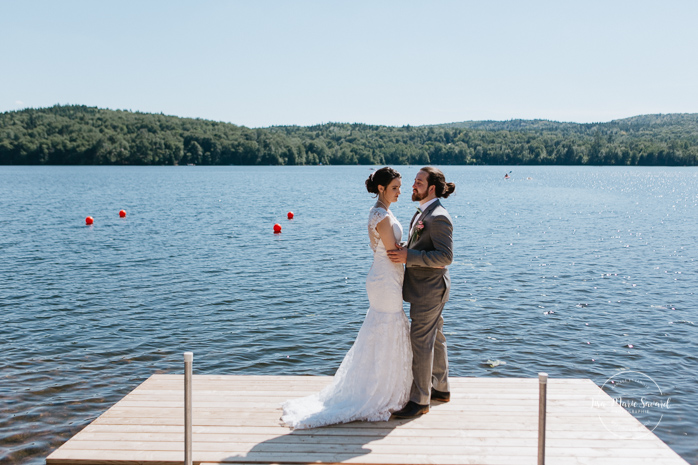 Wedding photos on dock. Bride and groom standing on dock next to a lake. Simple intimate wedding in Quebec City. Outdoor wedding in Quebec City. Quebec City wedding photographer. Mariage au Manoir du Lac Delage. Mariage à Québec. Photographe de mariage à Québec. Mariage Lac Delage | Lisa-Marie Savard Photographie | Montréal, Québec | www.lisamariesavard.com