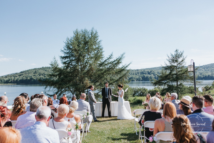Outdoor wedding ceremony by the lake. Bride reading her vows to the groom. Simple intimate wedding in Quebec City. Outdoor wedding in Quebec City. Quebec City wedding photographer. Mariage au Manoir du Lac Delage. Mariage à Québec. Photographe de mariage à Québec. Mariage Lac Delage | Lisa-Marie Savard Photographie | Montréal, Québec | www.lisamariesavard.com