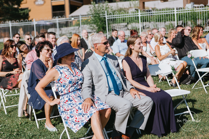 Outdoor wedding ceremony by the lake. Guests reactions during the ceremony smiling crying. Simple intimate wedding in Quebec City. Outdoor wedding in Quebec City. Quebec City wedding photographer. Mariage au Manoir du Lac Delage. Mariage à Québec. Photographe de mariage à Québec. Mariage Lac Delage | Lisa-Marie Savard Photographie | Montréal, Québec | www.lisamariesavard.com