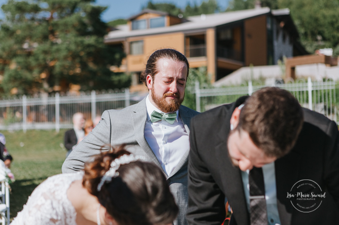 Outdoor wedding ceremony by the lake. Groom crying during ceremony. Simple intimate wedding in Quebec City. Outdoor wedding in Quebec City. Quebec City wedding photographer. Mariage au Manoir du Lac Delage. Mariage à Québec. Photographe de mariage à Québec. Mariage Lac Delage | Lisa-Marie Savard Photographie | Montréal, Québec | www.lisamariesavard.com