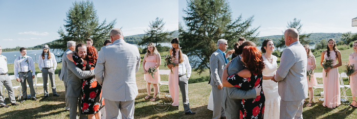 Outdoor wedding ceremony by the lake. Guests congratulating bride and groom after ceremony. Simple intimate wedding in Quebec City. Outdoor wedding in Quebec City. Quebec City wedding photographer. Mariage au Manoir du Lac Delage. Mariage à Québec. Photographe de mariage à Québec. Mariage Lac Delage | Lisa-Marie Savard Photographie | Montréal, Québec | www.lisamariesavard.com