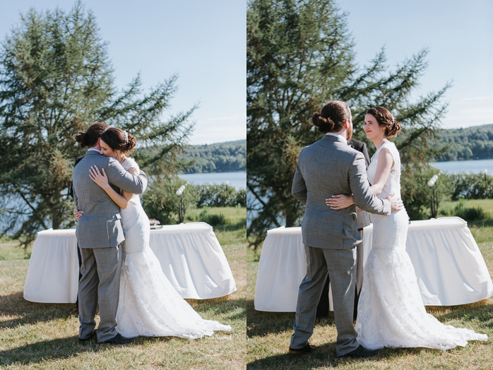 Outdoor wedding ceremony by the lake. Bride and groom hugging after first kiss. Simple intimate wedding in Quebec City. Outdoor wedding in Quebec City. Quebec City wedding photographer. Mariage au Manoir du Lac Delage. Mariage à Québec. Photographe de mariage à Québec. Mariage Lac Delage | Lisa-Marie Savard Photographie | Montréal, Québec | www.lisamariesavard.com
