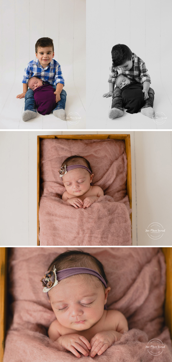 Newborn photo with sibling. Big brother with newborn sister. Sibling holding newborn baby in their arms. Big brother holding newborn sister in his arms. Newborn sleeping in wood crate with wool fluff. Newborn baby girl. Newborn session ideas. Simple clean minimalist newborn photos. Organic neutral newborn photos. Baby girl organic floral tie back headband. Photographe de nouveau-né à Montréal. Séance photo nouveau-né en studio à Montréal. Montreal newborn photographer. In-studio newborn session Montreal | Lisa-Marie Savard Photographie | Montréal, Québec | www.lisamariesavard.com