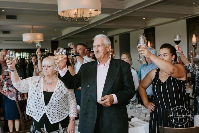 Bride and groom doing toast during reception. Mariage à Sainte-Agathe-des-Monts. Mariage an golf de Val-Morin. Photographe de mariage dans les Laurentides. Laurentians wedding photographer.