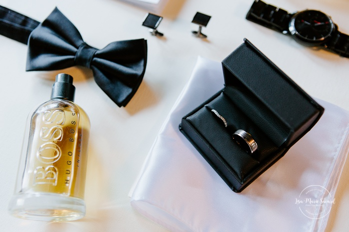 Wedding detail shots vow book, watch, cufflinks, bow tie, rings, handkerchief, Cologne and alcool. Mariage en Outaouais. Ouataouais wedding. Ottawa photographer.