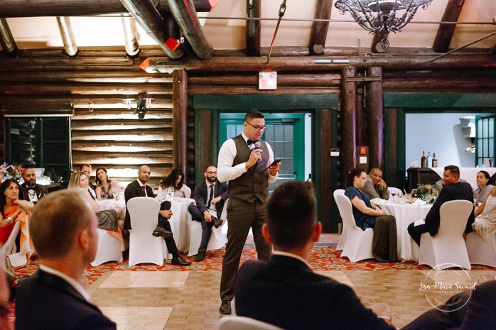 Groomsman speech during reception. Salle Héritage Château Montebello. Mariage en Outaouais. Fairmont Le Château Montebello. Ottawa photographer.