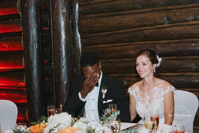 Newlyweds' parents doing a speech. Bride and groom crying. Salle Héritage Château Montebello. Mariage en Outaouais. Fairmont Le Château Montebello. Ottawa photographer.