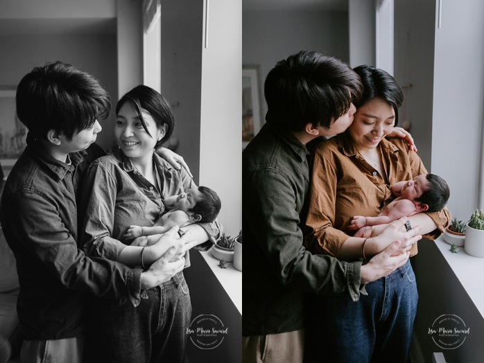Intimate in-home newborn session. Lifestyle newborn photos. Parents holding baby next to window. Photos de nouveau-né dans le Vieux-Montréal. Old Montreal newborn photographer. Montreal travel photographer.