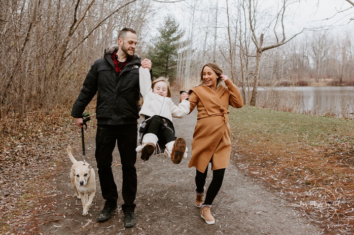 Family photos with dog. Family session with dog. Family walking hand in hand together. Parents swinging child. Maternity photos with child. Maternity photos with sibling. Photos de maternité dans le Sud-Ouest. Photographe de maternité à Ville-Émard. Montreal Southwest maternity photos.
