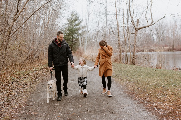 Family photos with dog. Family session with dog. Family walking hand in hand together. Parents swinging child. Maternity photos with child. Maternity photos with sibling. Photographe à Ville-Émard. Montreal Southwest maternity photos.